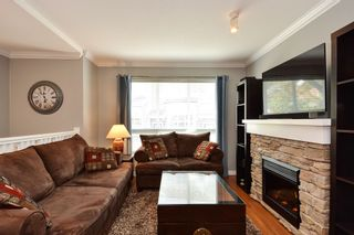 "Photo 3: 106 15168 36 Avenue in Surrey: Morgan Creek Townhouse for sale in ""SOLAY"" (South Surrey White Rock)  : MLS®# R2259870"