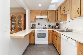 """Photo 13: 313 5335 HASTINGS Street in Burnaby: Capitol Hill BN Condo for sale in """"THE TERRACES"""" (Burnaby North)  : MLS®# R2327030"""