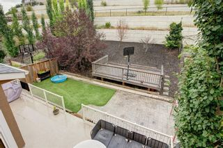 Photo 17: 127 Springbluff Boulevard SW in Calgary: Springbank Hill Detached for sale : MLS®# A1140601