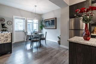 Photo 11: 374 Nolancrest Heights NW in Calgary: Nolan Hill Row/Townhouse for sale : MLS®# A1145723