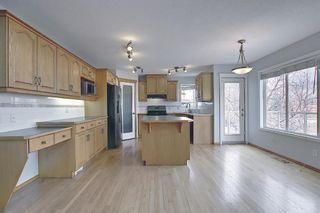 Photo 5: 22 Hidden Creek Green NW in Calgary: Hidden Valley Detached for sale : MLS®# A1091082