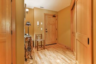 Photo 2: 1102, 101A Stewart Creek Landing in Canmore: Condo for sale : MLS®# A1096361