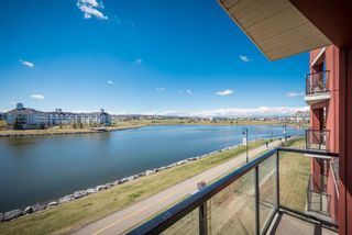 Photo 1: 210 156 Country Village Circle NE in Calgary: Country Hills Village Apartment for sale : MLS®# A1135703