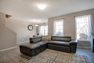Photo 5: 149 WINDSTONE Avenue SW: Airdrie Row/Townhouse for sale : MLS®# A1033066