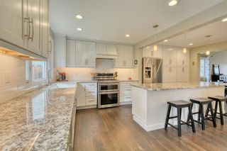 Photo 18: 104 Stratton Hill Rise SW in Calgary: Strathcona Park Detached for sale : MLS®# A1120413