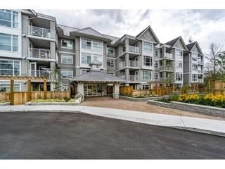 """Photo 2: 103 3136 ST JOHNS Street in Port Moody: Port Moody Centre Condo for sale in """"SONRISA"""" : MLS®# R2105055"""
