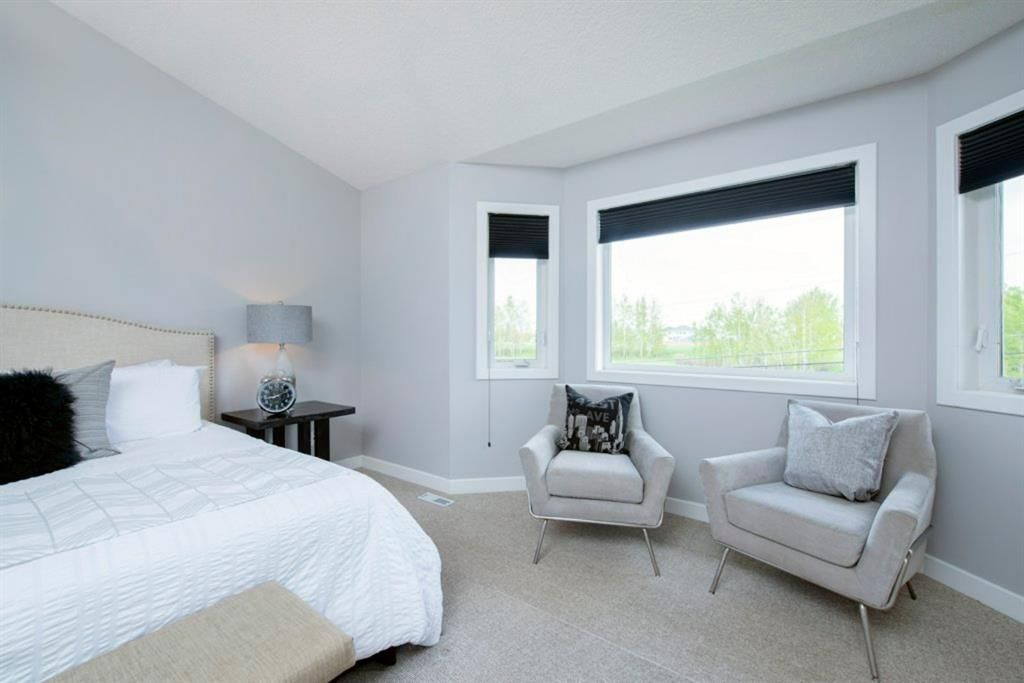 Photo 21: Photos: 32 Prominence Park SW in Calgary: Patterson Row/Townhouse for sale : MLS®# A1112438