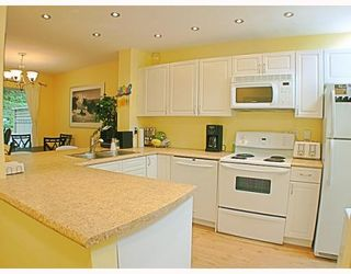 Photo 2: 20 2736 ATLIN Place in Coquitlam: Coquitlam East Townhouse for sale : MLS®# V781442