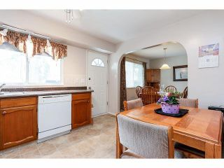 Photo 8: 9211 PRINCE CHARLES Boulevard in Surrey: Queen Mary Park Surrey House for sale : MLS®# F1409362