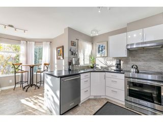 """Photo 15: 232 13900 HYLAND Road in Surrey: East Newton Townhouse for sale in """"Hyland Grove"""" : MLS®# R2519167"""