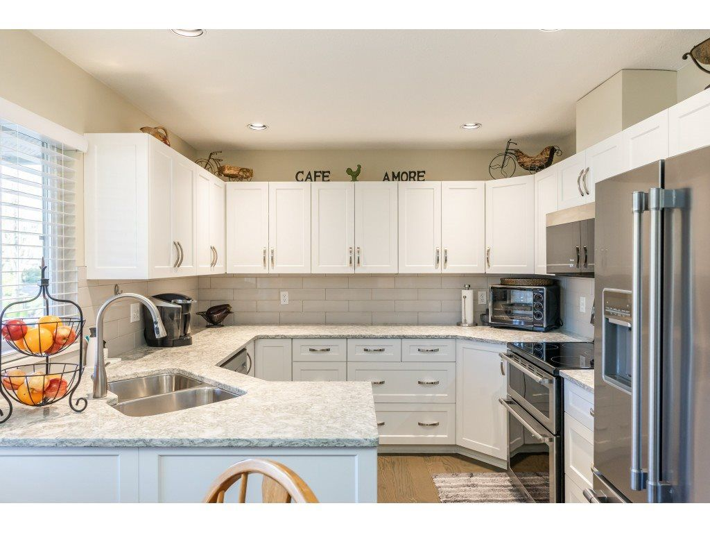 """Main Photo: 214 13888 70 Avenue in Surrey: East Newton Townhouse for sale in """"CHELSEA GARDENS"""" : MLS®# R2529339"""