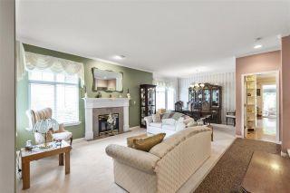 "Photo 5: 5822 122 Street in Surrey: Panorama Ridge Townhouse for sale in ""LakeBridge"" : MLS®# R2523031"