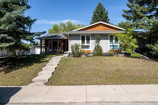 Photo 3: 9435 Paliswood Way SW in Calgary: Palliser Detached for sale : MLS®# A1095953