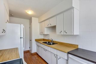 Photo 2: 7 6147 Buckthorn Road NW in Calgary: Thorncliffe Row/Townhouse for sale : MLS®# A1141165