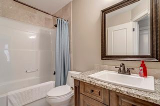 Photo 33: 111 Elmont Rise SW in Calgary: Springbank Hill Detached for sale : MLS®# A1099566