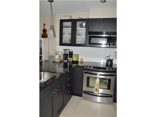 """Photo 5: 702 7225 ACORN Avenue in Burnaby: Highgate Condo for sale in """"AXIS"""" (Burnaby South)  : MLS®# V1087439"""