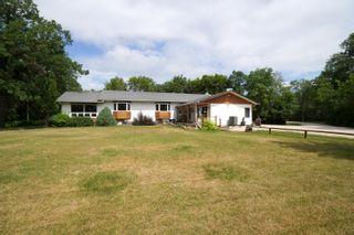 Photo 1: 39066 Road 64 N in Portage la Prairie RM: House for sale : MLS®# 202116718