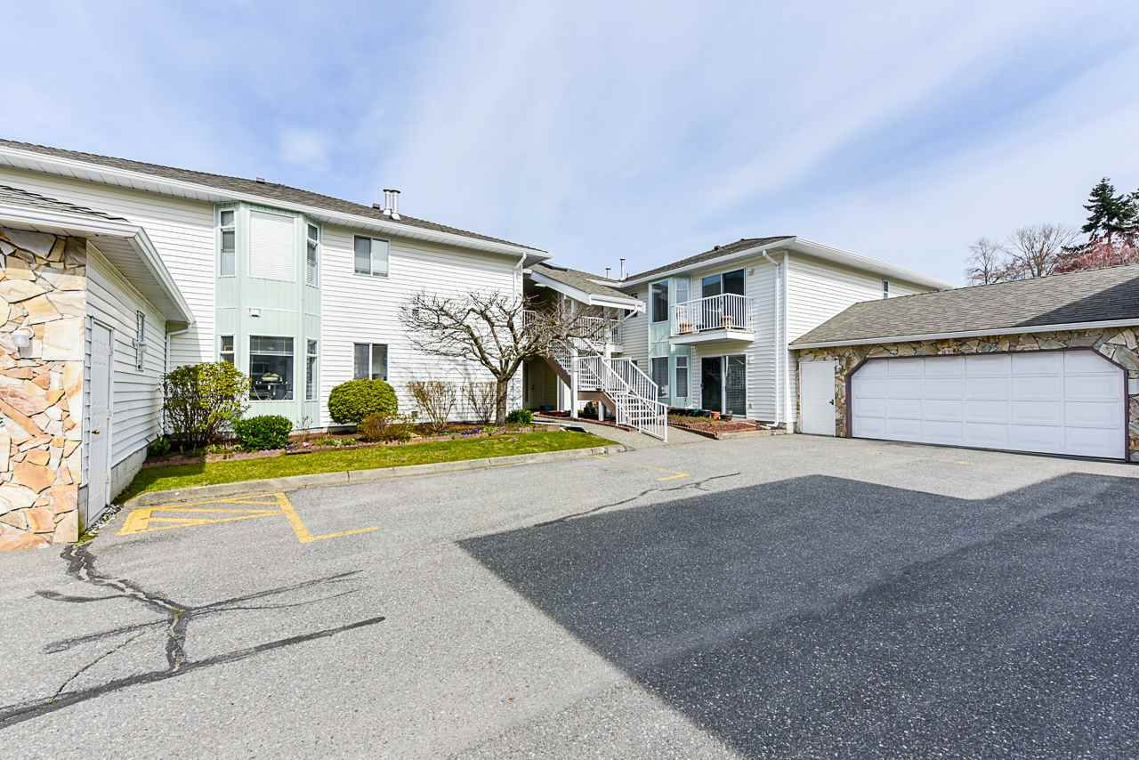 "Main Photo: 113 7156 121 Street in Surrey: West Newton Townhouse for sale in ""Glenwood Village"" : MLS®# R2546796"