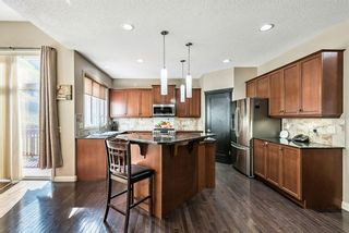 Photo 7: 157 Springbluff Boulevard SW in Calgary: Springbank Hill Detached for sale : MLS®# A1129724