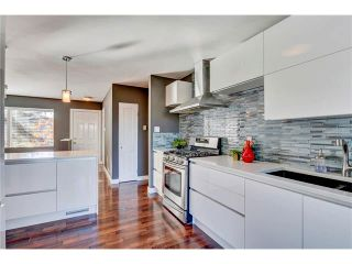 Photo 4: 5612 LADBROOKE Drive SW in Calgary: Lakeview House for sale : MLS®# C4036600