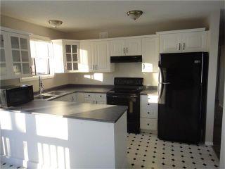 Photo 4: 527 Maplewood Drive: Black Diamond House for sale : MLS®# C4045958