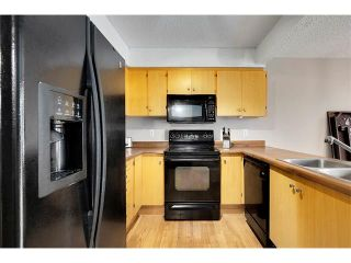 Photo 7: 24 WOODHILL Road SW in Calgary: Woodlands House for sale : MLS®# C4109351