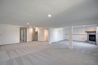 Photo 32: 124 Bow Ridge Court: Cochrane Detached for sale : MLS®# A1141194