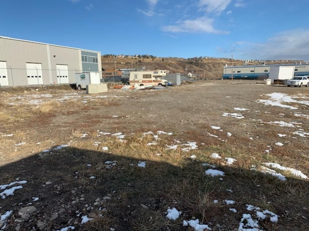 Main Photo: 14 GRIFFIN INDUSTRIAL Point: Cochrane Warehouse for sale : MLS®# A1099486