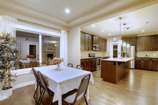 Photo 9: 1100 Brightoncrest Green SE in Calgary: New Brighton Detached for sale : MLS®# A1060195