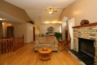 Photo 12: 2 WEST ANDISON Close: Cochrane House for sale : MLS®# C4141938