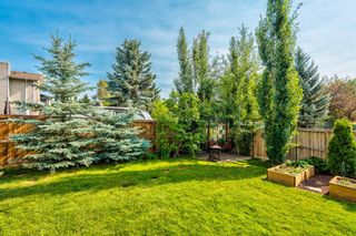 Photo 8: 104 Woodmark Crescent SW in Calgary: Woodbine Detached for sale : MLS®# A1128002