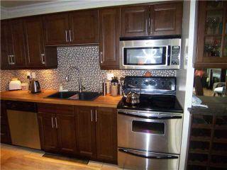 "Photo 2: 302 2381 BURY Avenue in Port Coquitlam: Central Pt Coquitlam Condo for sale in ""RIVERSIDE MANOR"" : MLS®# V891477"