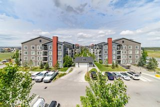 Photo 1: 1411 755 Copperpond Boulevard SE in Calgary: Copperfield Apartment for sale : MLS®# A1118335