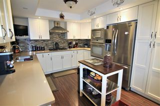 Photo 5: 14 448 Strathcona Drive SW in Calgary: Strathcona Park Row/Townhouse for sale : MLS®# A1062533