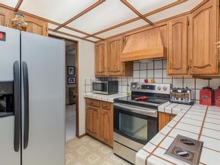 Photo 11: 9804 Palishall Road SW in Calgary: Palliser Detached for sale : MLS®# A1040399