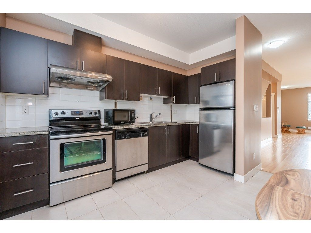 """Photo 16: Photos: 57 13899 LAUREL Drive in Surrey: Whalley Townhouse for sale in """"Emerald Gardens"""" (North Surrey)  : MLS®# R2527402"""