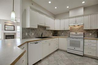 Photo 9: 1410 LAKE FRASER Green SE in Calgary: Lake Bonavista Apartment for sale : MLS®# C4294063