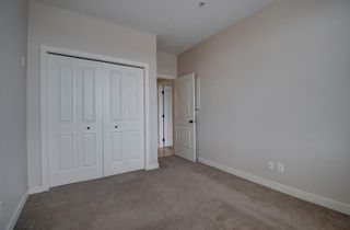 Photo 29: 304 132 1 Avenue NW: Airdrie Apartment for sale : MLS®# A1091993