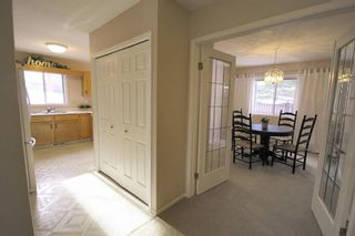 Photo 15: 15 Coach Side Terrace SW in Calgary: Coach Hill Row/Townhouse for sale : MLS®# A1071978