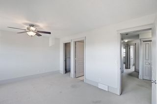 Photo 18: 63 Wentworth Common SW in Calgary: West Springs Row/Townhouse for sale : MLS®# A1124475