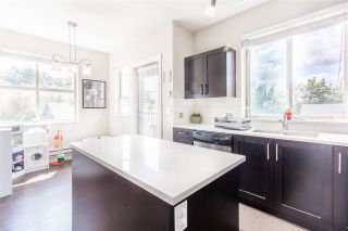 """Photo 3: 101 1418 CARTIER Avenue in Coquitlam: Maillardville Townhouse for sale in """"CARTIER PLACE"""" : MLS®# R2477824"""
