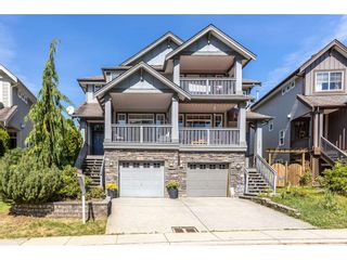 Photo 1: 105 FOREST PARK Way in Port Moody: Heritage Woods PM 1/2 Duplex for sale : MLS®# R2491120