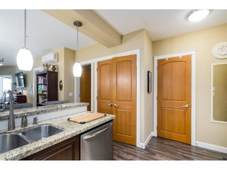 """Photo 6: A409 8218 207A Street in Langley: Willoughby Heights Condo for sale in """"Yorkson Creek (Final Phase) Walnut Ridge"""" : MLS®# R2597596"""