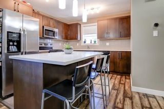 Photo 11: 401 1225 Kings Heights Way SE: Airdrie Row/Townhouse for sale : MLS®# A1126700