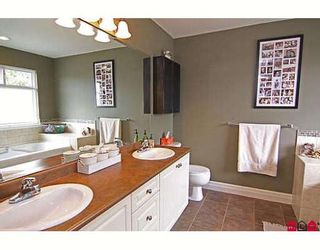 """Photo 9: 6814 198B Street in Langley: Willoughby Heights House for sale in """"ROUTELY WYND"""""""