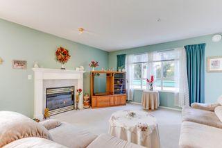 "Photo 4: 328 13880 70TH Avenue in Surrey: East Newton Condo for sale in ""Chelsea Gardens"" : MLS®# R2512963"