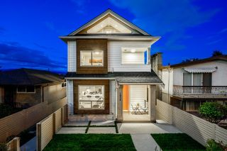 Photo 1: 1932 RUPERT Street in Vancouver: Renfrew VE 1/2 Duplex for sale (Vancouver East)  : MLS®# R2602045