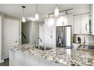 """Photo 10: 410 6490 194 Street in Surrey: Cloverdale BC Condo for sale in """"WATERSTONE"""" (Cloverdale)  : MLS®# R2535628"""