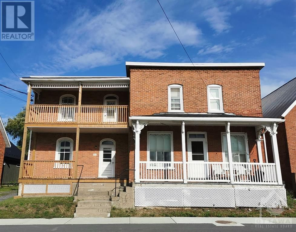 56 High Street is at left. Two stories, three bedrooms, new verandah, balusters in 2020, about 900 square feet of living space. 54 High Street is on the right, 3 bedrooms, 1105 square feet.