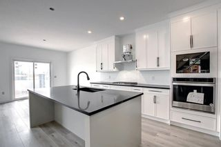 Photo 7: 126 Creekside Way SW in Calgary: C-168 Detached for sale : MLS®# A1144468